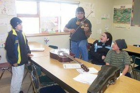 Robert Castel performing for some of his grade 8 Cree class