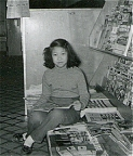 Sue-On taking a break at the Paris Cafe magazine rack