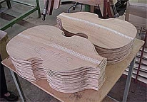 Beatle Bass tops-backs: computer machine carves out the bowl shapes