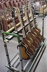 Basses awaiting tuning, intonation, truss rod adjustments