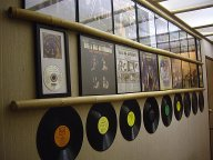 Bill and Sue-On Hillman Record Wall: Display of the duo's CDs, LPs, singles, covers, discs,