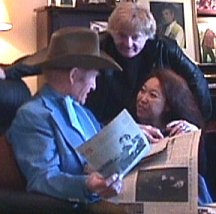 Russ  going over career clippings with Bill and Sue-On