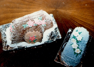 Yule Log with Poinsettas and Baby Boot with Apple Blossoms
